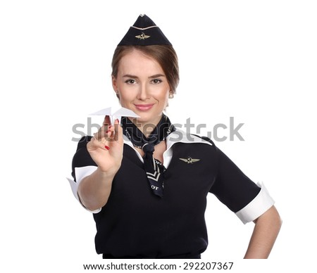 JUN 31, 2015 Air hostess in new uniform of national Russian airline Aeroflot, skyteam member. Holding Paper Plane In Hand. - stock photo