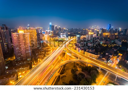 junction of city road at night  in prosperous shanghai , China  - stock photo
