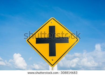 Junction traffic sign post, over blue sky - stock photo