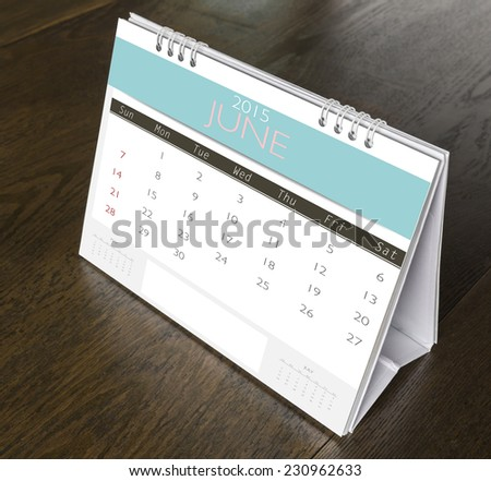 June Calendar 2015  on wood table - stock photo