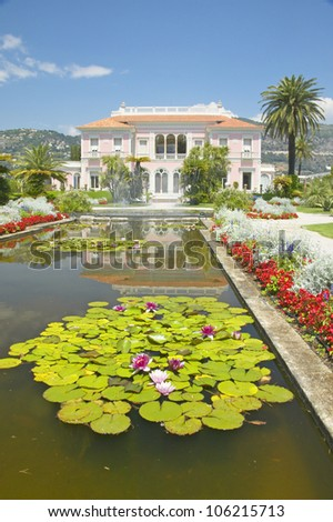 JUNE 2004 - Lilly pads and lotus flowers at The Gardens and Villa Ephrussi de Rothschild, Saint-Jean-Cap-Ferrat, France - stock photo