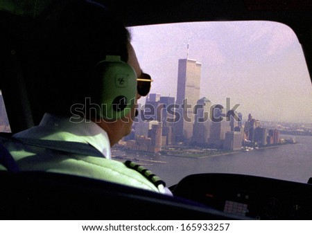 JUNE 1999 - NEW YORK: an aerial view from the inside of a helicopter towards the Twin Towers of the World Trade Center, Manhattan, New York. - stock photo