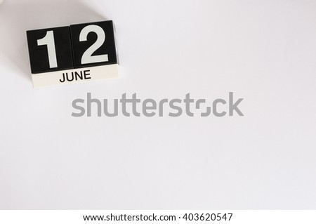 June 12th. Image of june 12 wooden color calendar on white background. Summer day. Empty space for text - stock photo