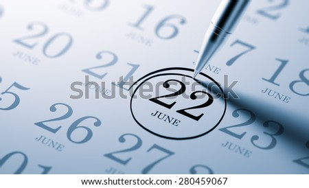 June 22 written on a calendar to remind you an important appointment. - stock photo