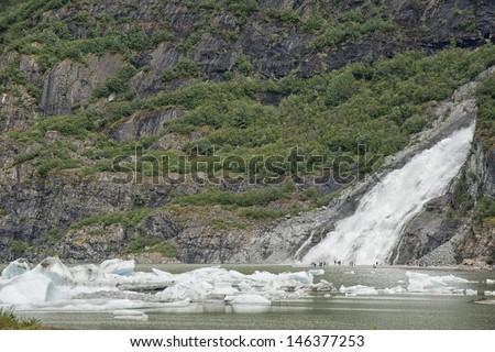 Juneau Alaska: Mendenhall glacier waterfall - stock photo