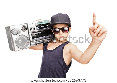 Junior rapper carrying a ghetto blaster and gesturing with his hand isolated on white background - stock photo