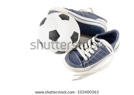Junior soccer ball with kids' shoes isolated on white - stock photo
