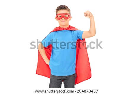 Junior superhero holding his fist in the air isolated on white background - stock photo