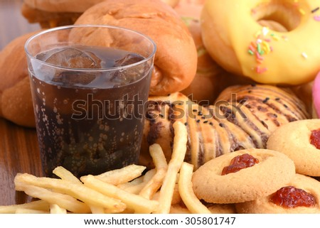 Junk food or fastfood and cola coke glass in restaurant  - stock photo