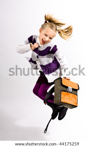 jupming school girl with school bag - stock photo