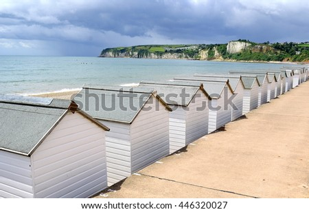 Jurassic Coast with beach huts in Seaton, Devon - stock photo