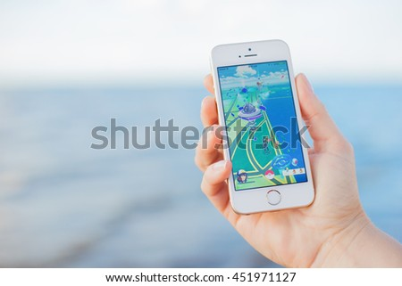 JURMALA, LATVIA - July 13, 2016: Pokemon Go gameplay screenshot on the phone. Pokemon Go is a location-based augmented reality mobile game. - stock photo