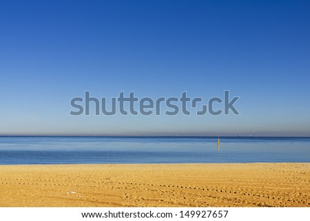 Just a colorful empty beach. - stock photo