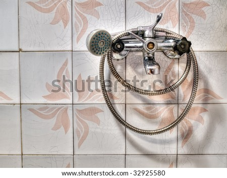 Just an old metal shower in HDR technique. - stock photo