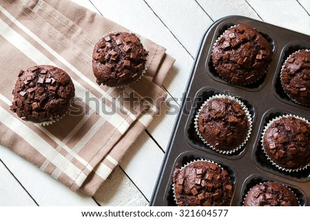 Just Baked Chocolate Muffins In Bakeware - stock photo