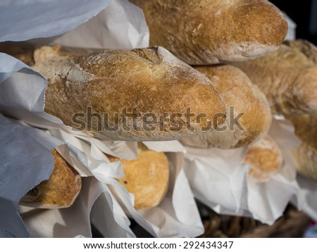 Just baked french baguettes for sale at farm market. - stock photo