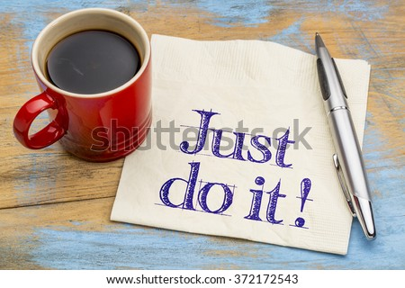 Just do it motivational advice on napkin with a cup of coffee. Motivation concept. - stock photo