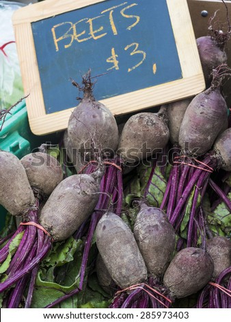 Just harvested beets for sale at farm market. - stock photo