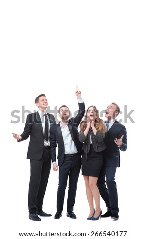 Just look at this! Full length of group of surprised and amazed business people looking and pointing up. Isolated on white. - stock photo