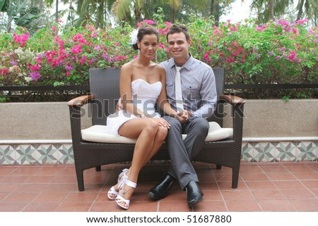 Just married bride and groom in a beautiful garden setting. - stock photo
