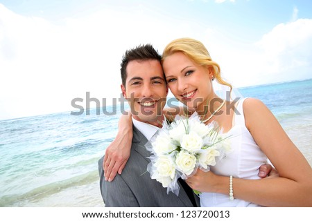 Just married couple at the beach - stock photo