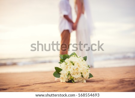 Just married couple holding hands on the beach, Hawaii Beach Wedding - stock photo