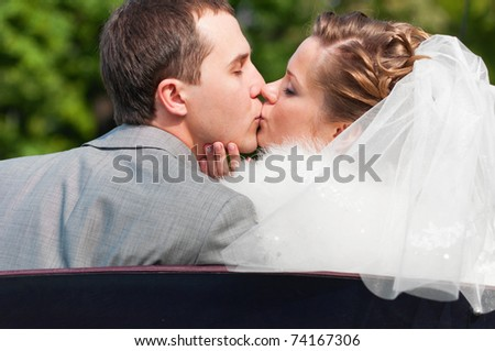 just married couple is kissing in park - stock photo