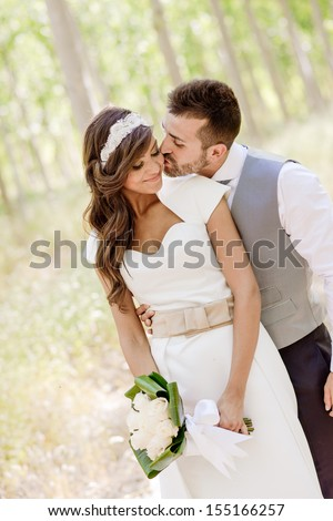 Just married couple together in nature background - stock photo