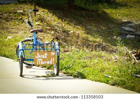 just Married tricycle - stock photo
