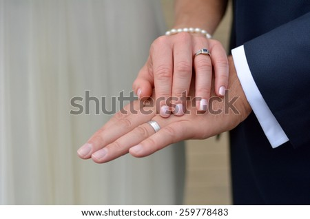 Just married young couple showing up their rings on their wedding Day. Wedding and marriage concept. copy space - stock photo
