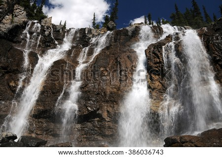 Just off the Athabasca highway, the five-pronged Tangle Creek Falls in Banff National Park, Alberta, Canada oscillates between a raging falls and a trickle, depending upon snow melt in any given year. - stock photo