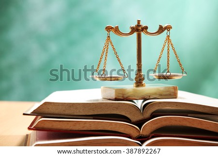 justice concept, book and scales of justice - stock photo