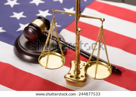 Justice Scale And Wooden Brown Gavel On Usa Flag - stock photo