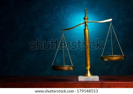 Justice scale with blue highlight in the background - stock photo