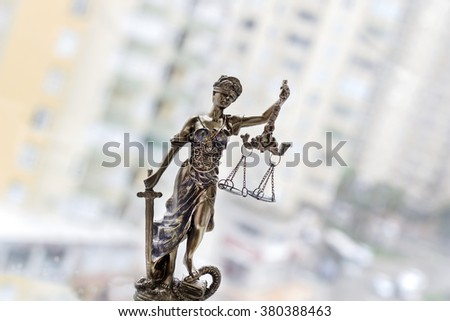 Justice statue with sword and scale. Law concept - stock photo