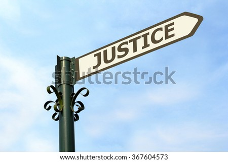 JUSTICE WORD ON ROADSIGN - stock photo