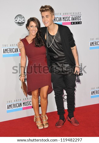 Justin Bieber & mother at the 40th Anniversary American Music Awards at the Nokia Theatre LA Live. November 18, 2012  Los Angeles, CA Picture: Paul Smith - stock photo