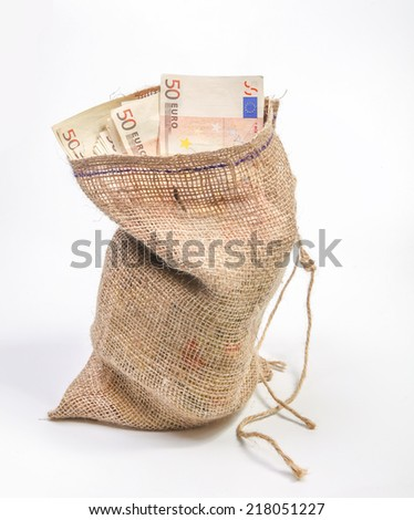 Jute bag filled with fifty euro bills - stock photo
