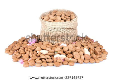 Jute bag filled with ginger nuts isolated over a white background - stock photo