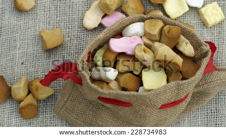 Jute bag with ginger nuts and candies, typical Dutch treat for Sinterklaas on 5 decembe - stock photo
