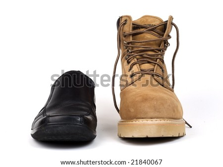 Juxtaposition of black dress shoe with brown work boot. Shot with infinity white background - stock photo