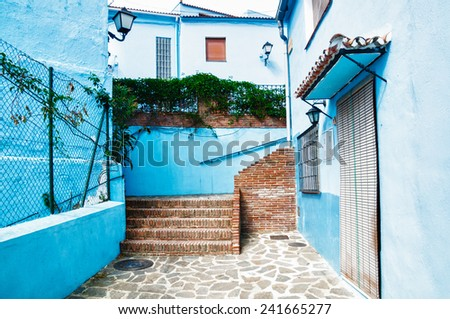 JUZCAR, SPAIN - SEPTEMBER 07:View of Juzcar on September 07,2014 in Juzcar, Spain. In 2011,buildings in the town were painted smurf-blue by Sony Pictures to celebrate the premiere of the Smurfs movie. - stock photo