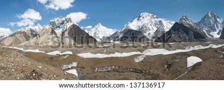 K2 and Karakorum Peaks Panorama at Concordia, Pakistan. K2, Broad Peak and Gasherbrum IV towering above Baltoro Glacier. - stock photo