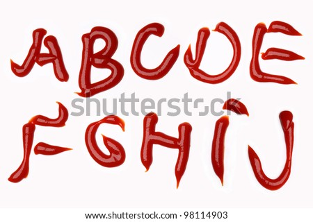 K-L-M-N-O-P-Q-R-S-T-U-V-W-X-Y-Z  alphabet letters made with tomato ketchup sauce on white background (isolated on white).  Make your own words in ketchup. - stock photo