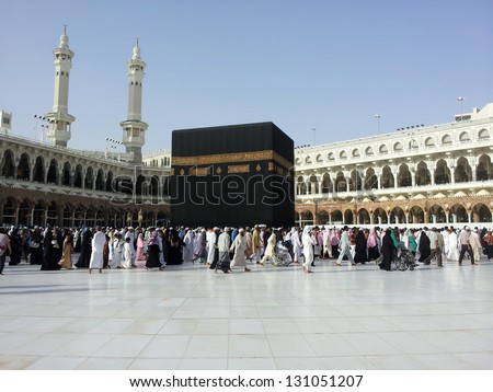 Kaaba Mecca in Saudi Arabia and Muslim pilgrims coming for Hajj (very rear images from inside the holy mosque) - stock photo