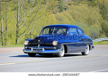 KAARINA, FINLAND - MAY 14, 2015: Classic black Mercury car in traffic. Mercury was a car brand of the Ford Motor Company launched in 1938 by Edsel Ford - stock photo