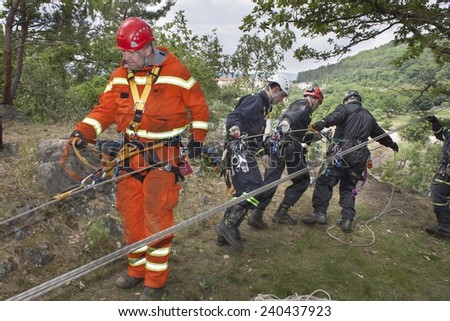 Kadan, Czech Republic, June 6, 2012: Exercise rescue units. Training rescue people in inaccessible terrain at the dam Kadan. Recovery using rope techniques - stock photo