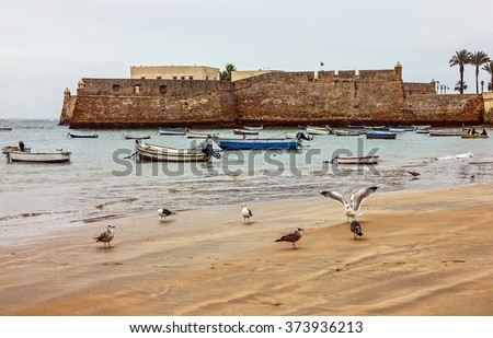 Kadiz beach, San Sebastian fortress, Spain - stock photo