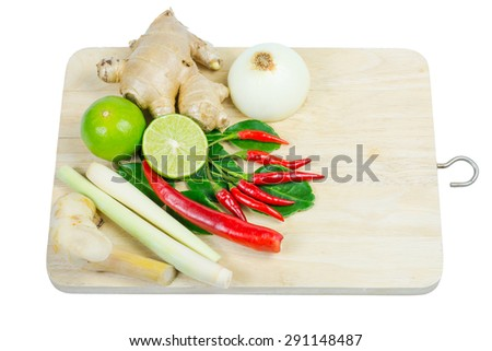 kaffir lime leaf, lemon, lemongrass, galangal, chili, onions, herb and spicy ingredients for making Thai food on wood background. - stock photo