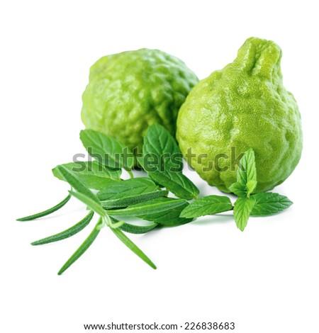 kaffir Lime or Bergamot fruit and fresh mint, rosemary is isolated on white background, closeup - stock photo